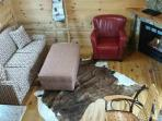 cozy great room with gas log fireplace, pull out sofa,with a ottaman and leather chair