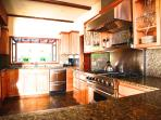 Custom kitchen with stainless steel gas stove