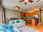 Open floor plan living/kitchen/dining area is inviting.
