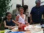 Some of the children have a go at making their own pizzas to cook in our wood-fired oven