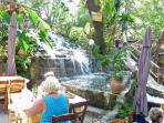 Visit the natural springs and dine at Argyroupolis