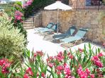 Sunbathe in the privacy of the Poolside Patio