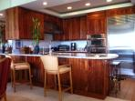 The kitchen with custom Koa cabinets
