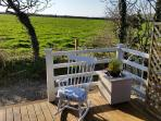 Take a moment to sit in the rocking chair on the decking and look across the fields to the sea.