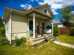 Lovely Downtown Missoula Home. Vibrant plants and landscaping fill the property.