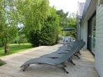 Terrace with sunloungers, ideal for relaxing and sunbathing.