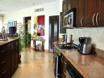 Fully equipped granite kitchen with breakfast bar