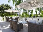 Manor House outside seating under the Willows and Umbrellas