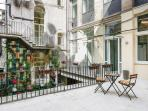 The nice terrace for your cup of coffe, with a table with  chairs