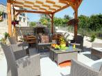 Sofa Set and Outdoor Dining Area under Pergola