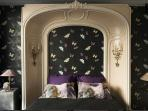 Master bedroom with butterfly paper wall