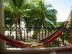 Relax at the hammock facing the Palm Trees and beach.