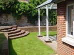 Walled terraced garden, lawn, BBQ area & covered decking