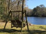 Double swing chair on river's edge