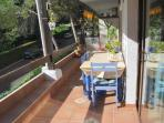 Double veranda with awnings easily sits four persons for meals. Lovely to relax after the beach