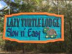 Entrance sign to the Lazy Turtle Lodge estate