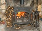 Settle in for the night (or day) with a lovely wood/coal burning stove