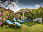 Relax on the sun loungers in the sun trap garden and top up your tan!