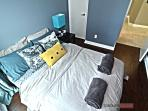 Modernly furnished 2nd bedroom with queen bed