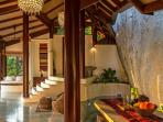 Carved into the natural rock formations on a forested Koh Samui hillside