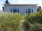 The Oceanfront Bungalow and the path to the seawall through the sand dune.