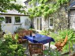 Enjoy eating al fresco in your own gorgeous courtyard garden full of exotic and unusual plants