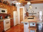 Full-size kitchen with gas range, convenient appliances, pots/pans all sizes, and gadgets gallore