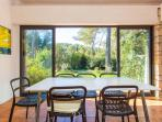 Dining room with verdant panoramic views