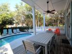 Private Pool Area with Outdoor Dining Table, Chaise Lounge Chairs and BBQ Grill