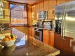 Kitchen Features Stainless Steel Appliances and Granite Countertops