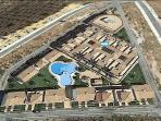 Aerial view of the complex with arrow highlighting our apartment