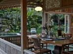 The terrace has a 8-seater teakwood dining table to enjoy alfresco meals.