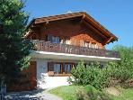 The summer view of the front of the chalet