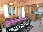 Dining area through to kitchen.
