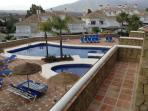 Gated complex outdoor pool with umbrellas, sun beds and toilet. Two minutes walk from the  house