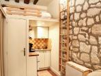general view (mezzanine, kitchen, door to bathroom)