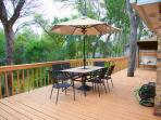 back deck with table and swing