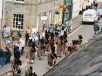 Street view from 9 Atholl Street showing pipe band