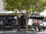 Enjoy a local coffee beneath one of the many verandahs.