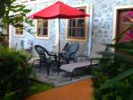 Private patio seating, tropical gardens