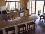 Kitchen with granite counter top and breakfast bar.
