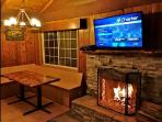 Flat screen TV and wood burning fireplace