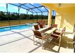 Extended south facing pool deck easily accommodates all guests