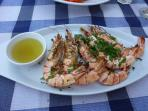 ENJOY A PLATE FRESHLY GRILLED PRAWNS FROM THE FISH RESTAURANT AT POTAMAS