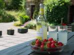 The courtyard is ideal for al fresco meals - anyone for strawberries and lashings of lemonade?