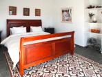 Master bedroom, with views over the garden and Riogordo,