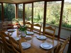 The sunroom with views of the fields, home to sheep, pheasants and rabbits!
