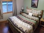 Bedroom 1: Queen bed with clock radio