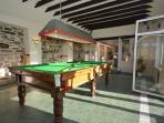 Snooker room with french doors onto enclosed garden