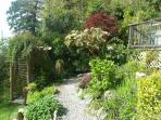 Shady paths and hidden corners made the small garden a delight to explore.
